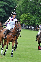 The MARCHIONESS OF MILFORD HAVEN playing polo (white shirt no 1.) at a charity polo match organised by Jaeger Le Coultre was held at Ham Polo Club, Richmond, Surrey on 12th June 2009.