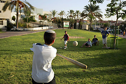 Children play a game of baseball at the Newe Deqalim settlement, Gaza, Palestinian Territories, Nov. 6, 2004. This particular settlement gets mortared regularly. Israel's parliament recently supported compensation payments for Jewish settlers leaving the Gaza Strip, in a vital vote for Prime Minister Ariel Sharon's plan to evacuate the occupied territory.