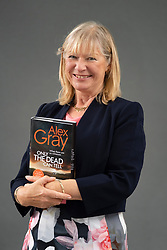 "Edinburgh, Scotland, UK; 17 August, 2018. Pictured; Glasgow crime writer Alex Gray with her new book ""Only the Dead Can Tell"" in which DSI Lorimer investigates a woman's brutal death and the husband who is the prime suspect."