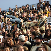 Fans celebrate in the stands during an NCAA football game between the Memphis Tigers and the Central Florida Knights at Bright House Networks Stadium on Saturday, October 29, 2011 in Orlando, Florida. (AP Photo/Alex Menendez)