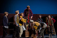 """Topher Weimann """"Fagin"""" with Fagin's gang during dress rehearsal Tuesday evening for the musical """"Oliver"""" at Gilford High School.  (Karen Bobotas/for the Laconia Daily Sun)"""