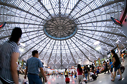 Interior of spectacular new Shanghai West railway Station with arge circular glass roof