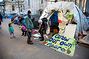 Tents and signs containing slogans at the Occupy London OLSX protest site at St. Paul's, London, UK. The site is slowly being cleared, although some are staying until they are evicted, possibly within the coming days. The 'Occupy' movement spread via social media. The protests have been organised on social media pages that between them have picked up more than 15,000 followers.