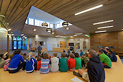 A photo of the morning all school meeting in the central meeting space.
