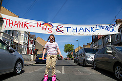 © Licensed to London News Pictures. 20/05/2020. London, UK. Yanky, 9 years old walks under a 'THANK YOU NHS and THANK YOU HATZOLA from Elm Park resident' banner on Elm Park  in Tottenham, north London. The local residents show their appreciation for the efforts of the NHS staff during the COVID-19 pandemic. <br /> <br /> ***Permission Granted***<br /> <br /> Photo credit: Dinendra Haria/LNP