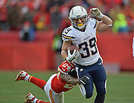 KANSAS CITY, MO - NOVEMBER 24:  Running back Danny Woodhead #39 of the San Diego Chargers rushes up field against defensive back Brandon Flowers #24 of the Kansas City Chiefs during the second half on November 24, 2013 at Arrowhead Stadium in Kansas City, Missouri.  San Diego won 41-38. (Photo by Peter Aiken/Getty Images) *** Local Caption *** Danny Woodhead;Brandon Flowers