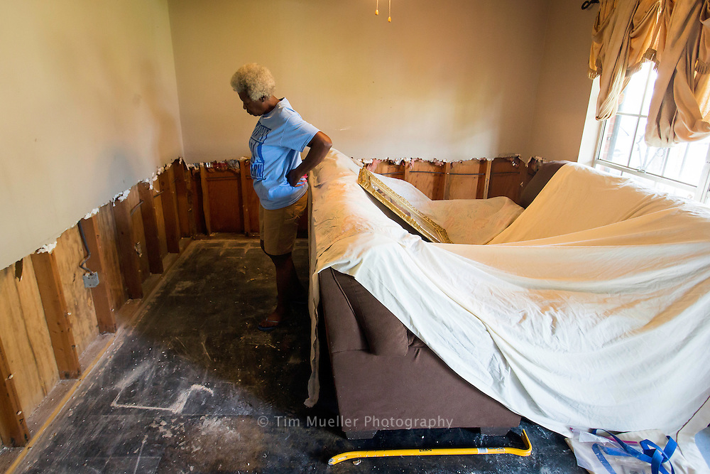 Shirley Burrell looks over her front room as Together Baton Rouge volunteers help gut her home Saturday, Sept. 3, 2016 nearly three weeks after the heavy rains caused widespread flooding. 84 volunteers formed 14 teams and helped 15 homeowners clear their flood damaged homes. The Baton Rouge Area Foundation donated $250,000 to Together Baton Rouge to create 100 jobs paying $15 per hour to house-gutting and mold remediation. Together Baton Rouge is gutting the homes of families with the greatest need, the elderly, disabled and families with children.