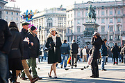 People walk through Piazza del Duomo, central Milan on 8th December 2008 in Milan, Italy. The piazza is the main city square in Milan, and is culturally, aesthetically and socially important to the city.