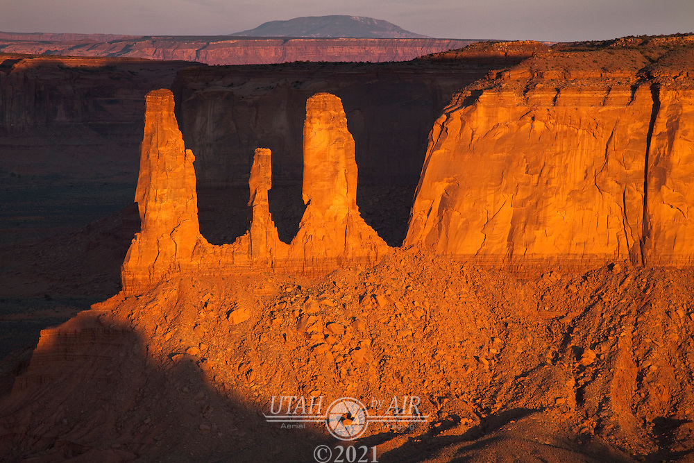 Three Sisters formation. Looking west in Monument Valley