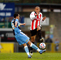 Photo: Marc Atkins.<br /> <br /> Wycombe Wanderers v Cheltenham Town. Coca Cola League 2, Play off Semi Final. 13/05/2006. Danny Senda of Wycombe has his cross charged down by Ashley Vincent (R).
