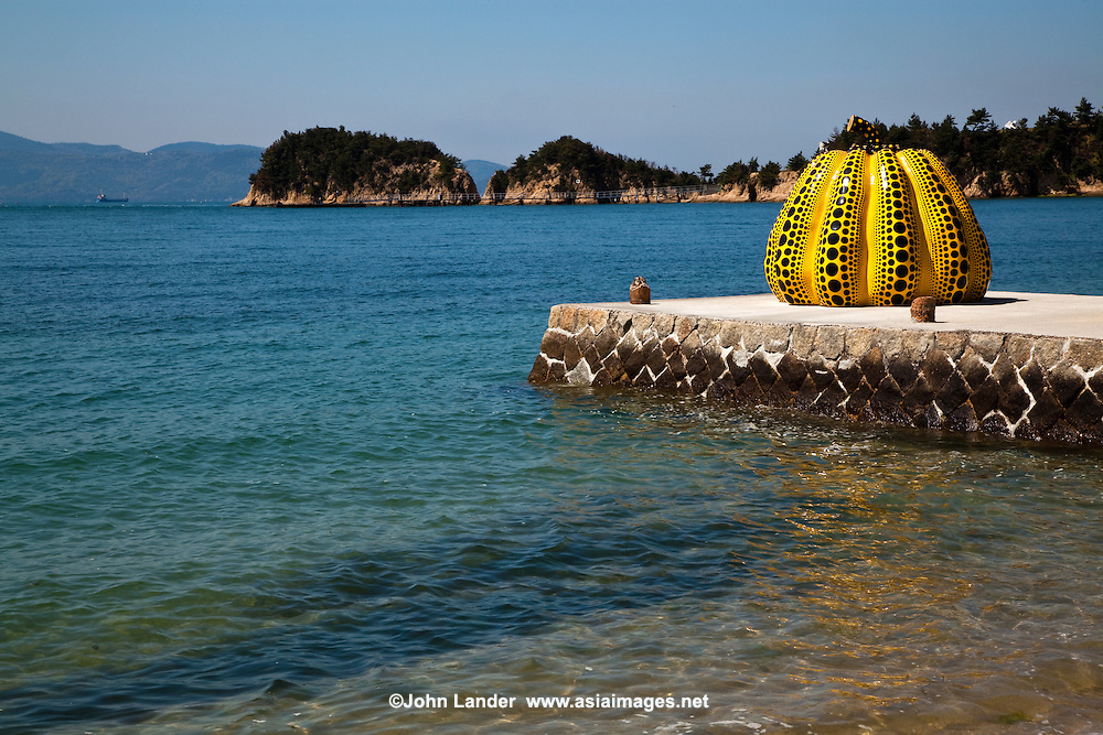 The bright yellow pumpkin covered with a pattern of black dots stands about two meters high. Created by Kusama Yayoi in 1994 it has  served as a symbol of the entire Naoshima art project and over time it has been joined by other pieces integrated with Naoshima's landscape.