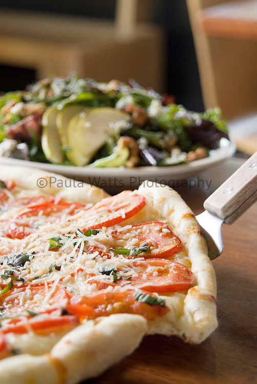 Pizza slice with salad