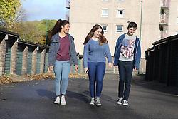 View of teenagers walking