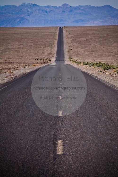 Empty highway running through Death Valley in Nevada.