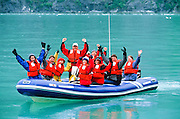 Alaska. Southeast. Rafting in southeast, Tourism. Happy people who just watched a glacier calving.