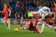 Tom Lawrence of Rotherham Utd (34) sees his shot at goal blocked by Cardiff's Ben Turner.Skybet football league championship match, Cardiff city v Rotherham Utd at the Cardiff city stadium in Cardiff, South Wales on Saturday 6th December 2014<br /> pic by Andrew Orchard, Andrew Orchard sports photography.