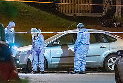 © Licensed to London News Pictures. 18/05/2020. London, UK. Forensic investigators search for evidence around a silver car parked on Wiltshire Gardens, a police tent sits in the background. Police were called at 20:22BST to reports of shots fired in Wiltshire Gardens in Haringey. Metropolitan Police Service attended along with London Ambulance Service and found a man, believed to be aged in his 20s, suffering gunshot injuries. The man was pronounced dead at the scene. Photo credit: Peter Manning/LNP