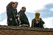 Housing activists occupy a rooftop on the Sweets Way housing estate close to the home of its last surviving resident, Mostafa Aliverdipour, on 23rd September 2015 in London, United Kingdom. A group of housing activists calling for better social housing provision in London had occupied some of the properties on the 142-home estate in Whetstone, in some cases refurbishing properties intentionally destroyed by the legal owners following eviction of the original residents, in order to try to prevent or delay the eviction of Mr Aliverdipour and the planned demolition and redevelopment of the entire estate by Barnet Council and Annington Property Ltd.