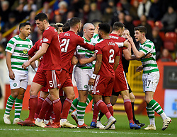 Celtic's Scott Brown (centre) and Aberdeen's Shay Logan exchange words during the Scottish Premiership match at Pittodrie Stadium, Aberdeen.