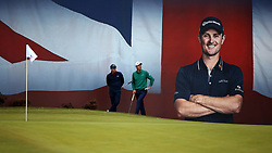 Justin Rose and Matthew Fitzpatrick on the 18th during day two of the British Masters at Walton Heath Golf Club, Surrey.