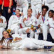 TOKYO, JAPAN August 8:  United States players Chelsea Gray, Sue Bird, Diana Taurasi, Sylvia Fowles, Tina Charles and Brittney Griner celebrate with their gold medals at the medal presentation ceremony after the Japan V USA basketball final for women at the Saitama Super Arena during the Tokyo 2020 Summer Olympic Games on August 8, 2021 in Tokyo, Japan. (Photo by Tim Clayton/Corbis via Getty Images)
