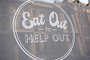 As numbers of Covid-19 cases in Birmingham have dramatically risen in the past weeks, increased lockdown measures have been announced for Birmingham and other areas of the West Midlands, a sign for the now finished 'Eat Out To Help Out' campaign on 29th September 2020 in Birmingham, United Kingdom. With the rule of six also being implemented the Birmingham area has now be escalated to an area of national intervention, with a ban on people socialising with people outside their own household, unless they are from the same support bubble.