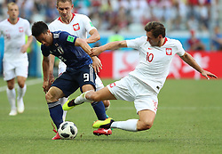 VOLGOGRAD, June 28, 2018  Grzegorz Krychowiak (R front) of Poland vies with Shinji Okazaki (L front) of Japan during the 2018 FIFA World Cup Group H match between Japan and Poland in Volgograd, Russia, June 28, 2018. (Credit Image: © Yang Lei/Xinhua via ZUMA Wire)