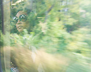 Reflection through a window on a moving Train.