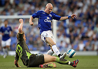 Photo: Paul Thomas.<br /> Everton v Werder Bremen. Pre Season Friendly. 31/07/2007.<br /> <br /> Andy Johnson of Everton jumps to avoid the tackle of Per Meertesacker.