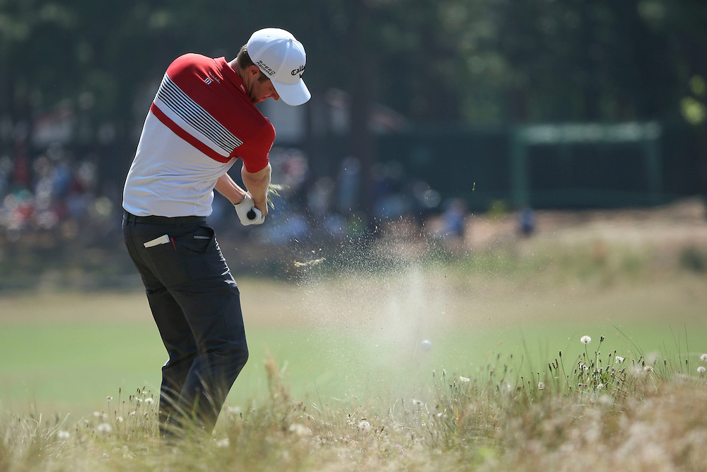 Jun 15, 2014; Pinehurst, NC, USA;  Chris Kirk hits from the fifth waste area during the final round of the 2014 U.S. Open golf tournament at Pinehurst Resort Country Club - #2 Course. Mandatory Credit: Kevin Liles-USA TODAY Sports