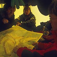 INTERNATIONAL ARCTIC PROJECT, Expedition members plot most efficient route from North Pole to Ellesmere Island.