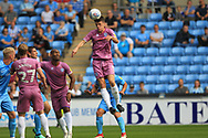Ryan Delaney heads at goal during the EFL Sky Bet League 1 match between Coventry City and Rochdale at the Ricoh Arena, Coventry, England on 1 September 2018.