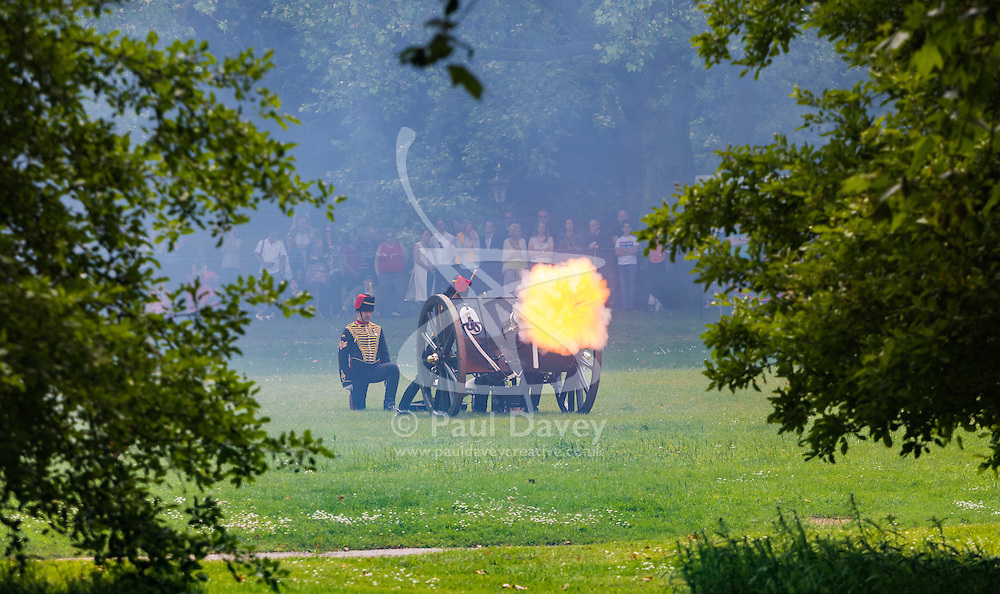 Green Park, London, June 11th 2016. Marking Her Majesty The Queen's official birthday, the Royal King's Horse Artillery fires a 41-Gun-Salute in Green Park. PICTURED: The moment a gun fires, emitting a concussive blast of flame.
