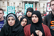 Rally organised by Stop the War coalition  in Trafalgar Square to mark 10 years of war in Afghanistan. The crowd listen to speeches.
