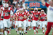 DALLAS, TX - AUGUST 30: The SMU Mustangs take the field before kickoff against the Texas Tech Red Raiders on August 30, 2013 at Gerald J. Ford Stadium in Dallas, Texas.  (Photo by Cooper Neill/Getty Images) *** Local Caption ***