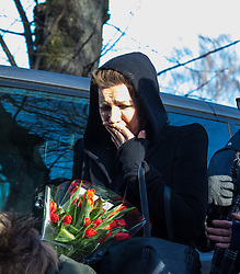 Highgate, London, December 26th 2016. Fans gather outside the London home of pop icon George Michael who died on Christmas day. PICTURED: A tearful woman arrives at Michael's house with flowers.