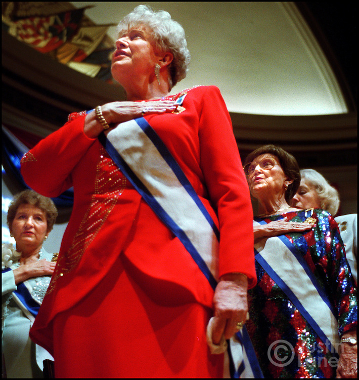 04/17/00--Washington---DAR/JSL.Attn: Sharon Yemich/Sunday Magazine, .For Sabrina Eaton Story.The 109th Continental Congress of the National Society, Daughters of the American Revolution held their annual meeting this week in Washington DC. Monday night was the opening ceremony at Constitution Hall where members, including Darla E. Kemper, in red in center, recited the Pledge of Alligence..JUSTIN LANE FOR THE CLEVELAND PLAIN DEALER