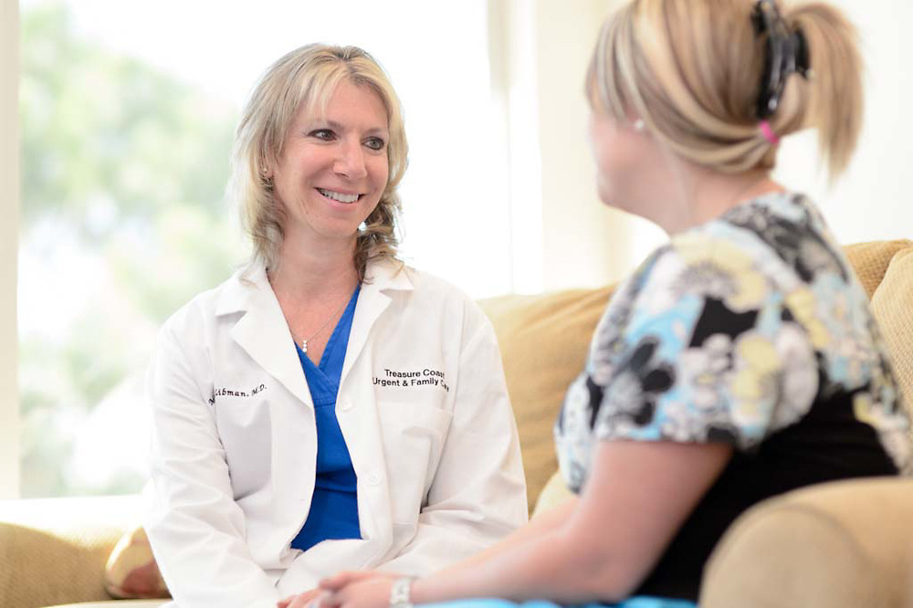 Dr. Michele Libman consults with a patient at the Treasure Coast Urgent and Family Care in Stuart, Florida