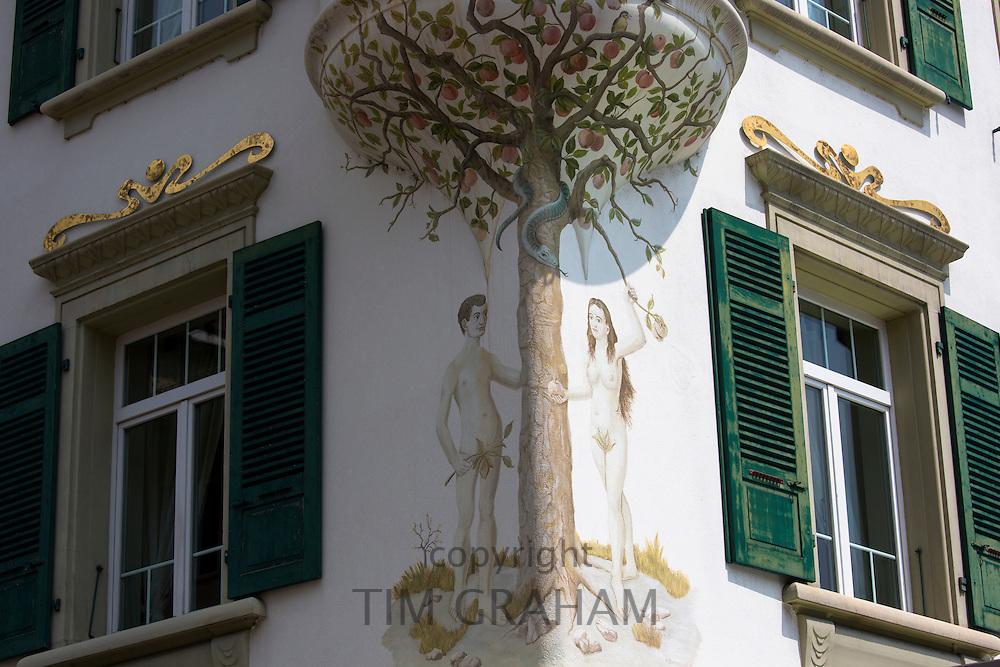 Mural of Adam and Eve in garden of Eden religious scene in Marktplatz  at Interlaken, Bernese Oberland, Switzerland