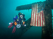 KISS Spirit rebreather diver by the Sikorsky H-37 Aircraft and American flag in Dutch Springs, Pennsylvania.