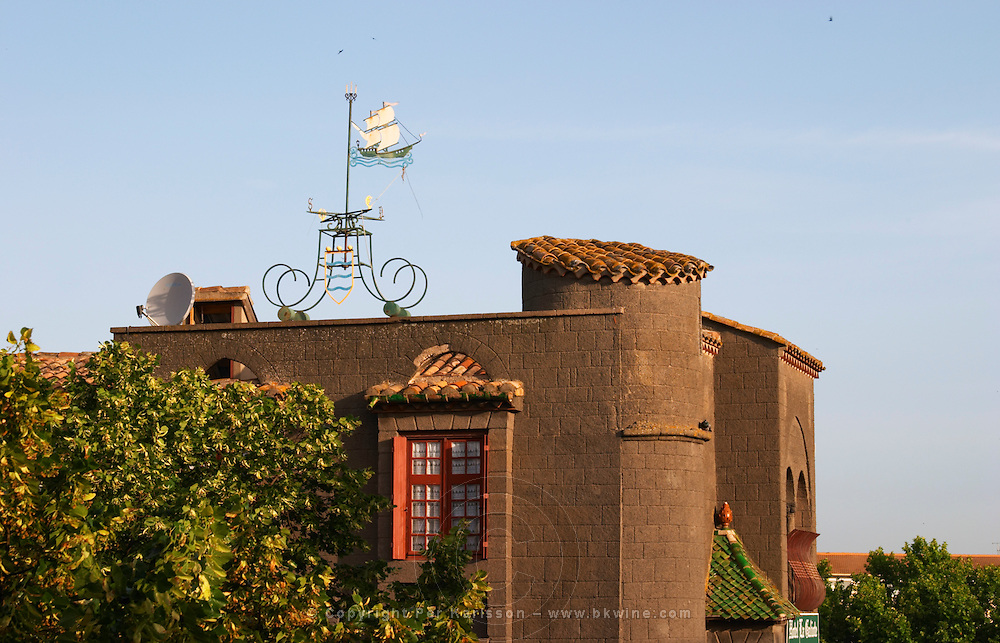 The La Galeote hotel. Weather vane in the form of a sailing ship with indication of compass directions. Agde town. Languedoc. France. Europe.