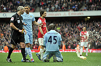 Premier League Arsenal v Manchester City<br />Red card for Mario Balotelli as a bottle is thrown onto the pitch by Man City fans