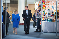 © Licensed to London News Pictures . 30/09/2014 . Birmingham , UK . DAVID CAMERON arrives at the LBC stand this morning for an interview with Nick Ferrari . The 2014 Conservative Party Conference in Birmingham . Photo credit : Joel Goodman/LNP