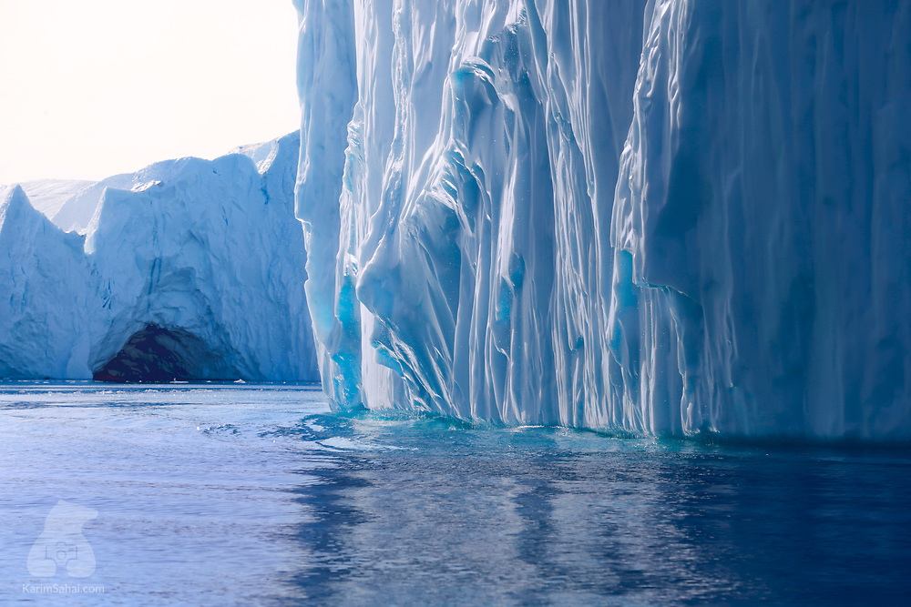 Getting close to an iceberg in Ilulissat icefjord on a windless day, West Greenland