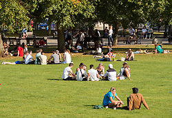 "© Licensed to London News Pictures; 21/09/2020; Bristol, UK. Young people sit on College Green. Groups of people, some more than six in number, enjoy the sunshine and hot weather on the last official day of summer in Bristol city centre, amid concerns about a second wave of the covid-19 coronavirus pandemic across the UK, with many areas going into local lock down. From Monday 14 September it was illegal to meet up socially in groups of more than six people, known as the ""Rule of Six"", in order to try and contain the spread of the covid-19 coronavirus pandemic, and police have said they will enforce the law with fixed penalty notices which will increase for repeat offenders. Photo credit: Simon Chapman/LNP."