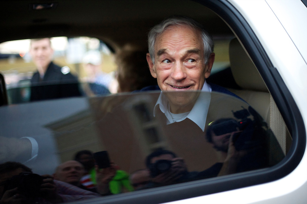 Republican Presidential candidate Ron Paul greets fans from his vehicle after holding a town hall meeting at the Holiday Inn in Rock Hill, South Carolina in advance of the primary on 21 January.