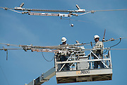 Lineman put the finishing touches on installing switches at a power substation near Perry, OK.
