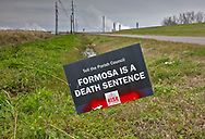 Protest signs against Formosa in St. James, LA.
