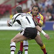 © Intersport Images .Photo Peter Spurrier.12/05/2002.Sport - Rugby League.London Broncos vs Widnes Vikings.Deniss Moran tackled by Stuart Spruce....