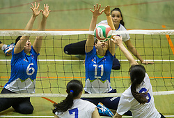 Suzana Ocepek of Slovenia and Lena Gabrscek of Slovenia vs Peng Giyuan of China during friendly Sitting Volleyball match between National teams of Slovenia and China, on October 22, 2017 in Sempeter pri Zalcu, Slovenia. (Photo by Vid Ponikvar / Sportida)
